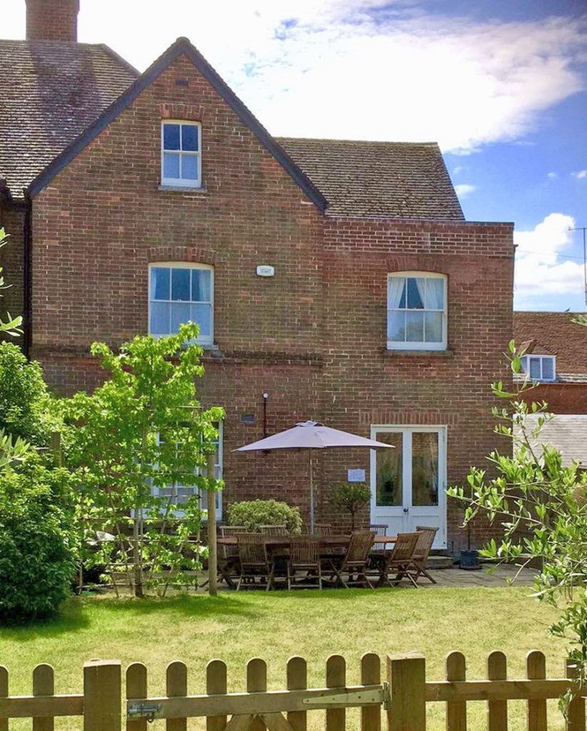 Quay Corner well kept garden perfect for outside dining and lovely views of the properties vintage sash windows
