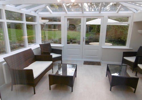 Beck Cottage conservatory with ratten sofas and beautiful views of the garden