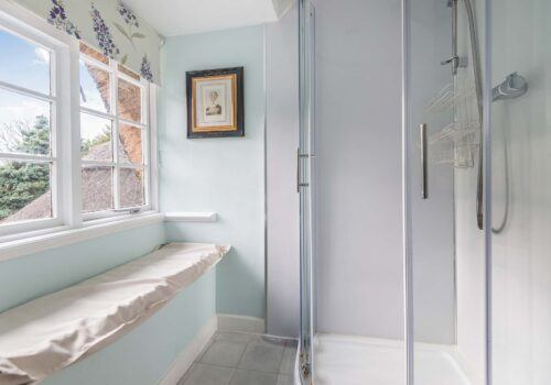 Self Catering Cottage Beck Cottage Full shower cubicle with seating area and views of garden