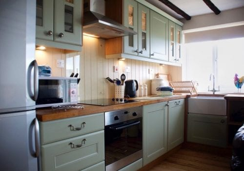 Fully fitted kitchen at Coshes Cottage in a smart green shade