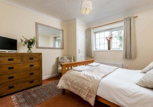 Self catering holiday home Criddlestyle Cottage bedroom with chair