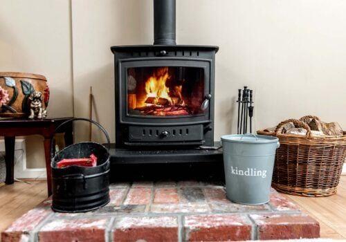 Holiday Cottage Hampshire Wood burner and logs Criddlestyle Cottage