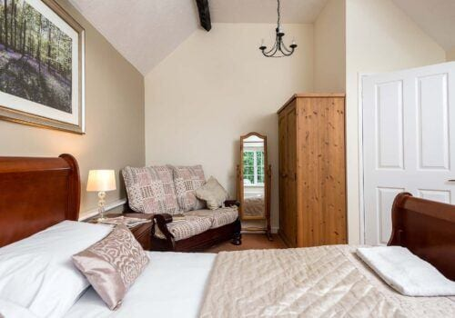 Hampshire holiday home master bedroom with seating area