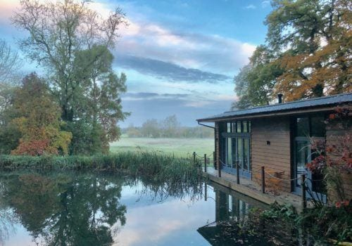 Riverside Lodge in a beautiful setting on the River Stour near the New Forest, peace and tranquil for alfresco dining on the outside decking area
