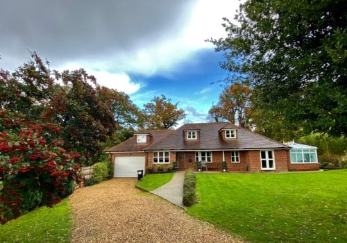 Mews Hill Front aspect of the self catering cottage with large lawned area in the New forest Hampshire