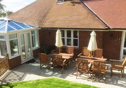 Patio with outdoor furniture and conservatory