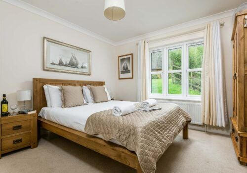 A maritime theme to this spacious guest bedroom