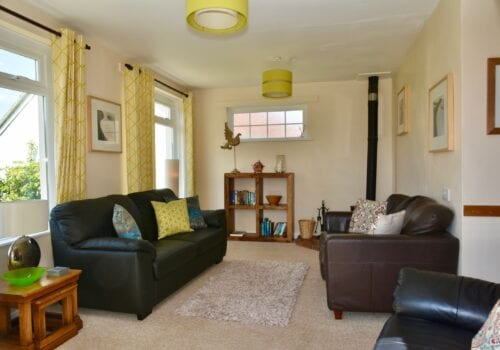 Lounge with woodburner in Devon holiday let