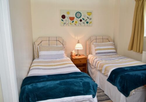 Twin beds with blue bedspreads