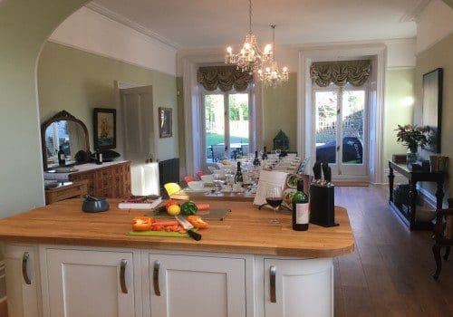 Spacious dining kitchen with table laid for 15 guests