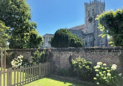 Quay House fantastic garden view of Christchurch Priory surrounded by beautiful flowers and trees