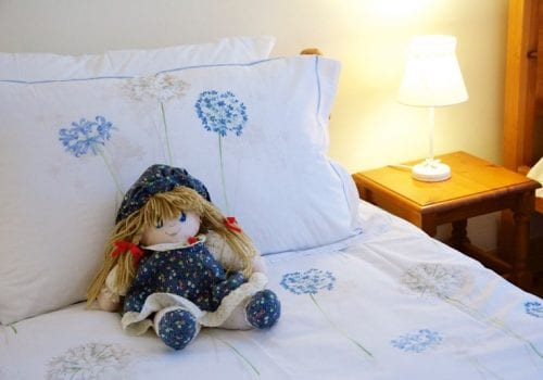 Pretty bedroom at South Farm Cottages, perfect for kids