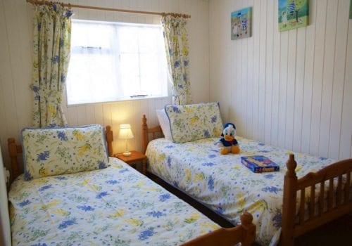 Pretty bedroom at Stables Cottage at South Farm Devon