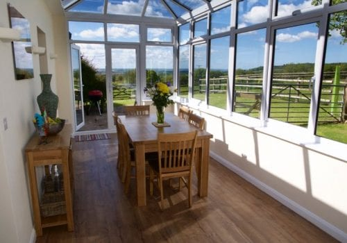 Spacious conservatory at Stables Cottages with far reaching views