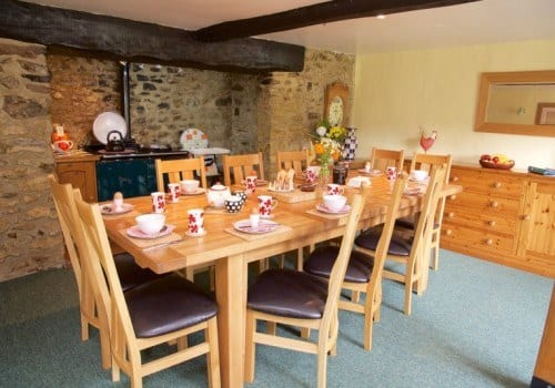 Kitchen table by the aga in this holiday cottage to let in Devon