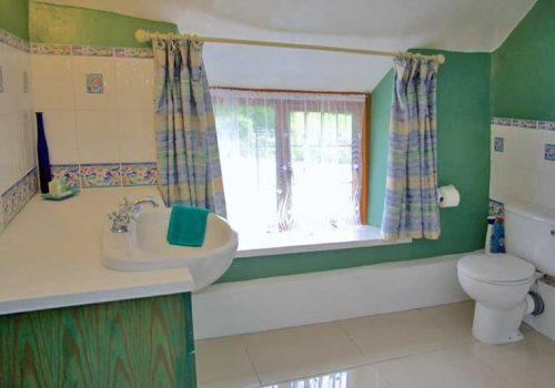 Family bathroom with colourful decor at The Farm House