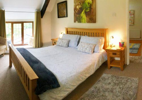 Double Bedroom with large window and dramatic artwork