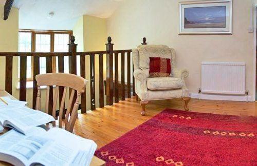 Mezzanine floor with sofa and desk area