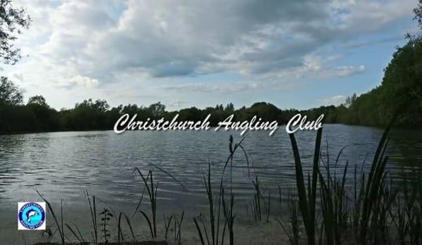 Lake on a cloudy day with Christchurch Angling Club logo