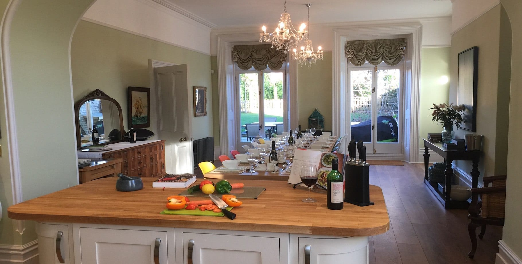 The large dining kitchen at Quay House with the table laid for guests