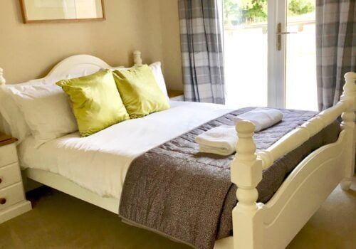Double bedroom with bedspread and fresh linen