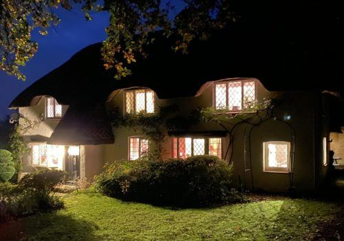 Night Scene of a picturesque thatched self catering cottage in the New Forest perfect home for a rural retreat