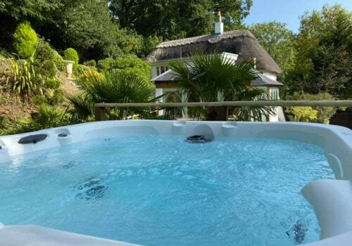 Hot tub with cottage and garden view