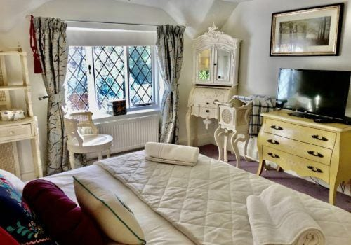 French Style Master bedroom in New Forest Self Catering Cottage