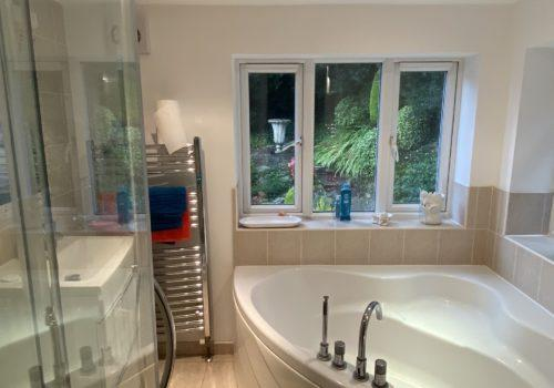 take time to relax in this luxurious bath at our holiday rental cottage Forest Drove in the New Forest
