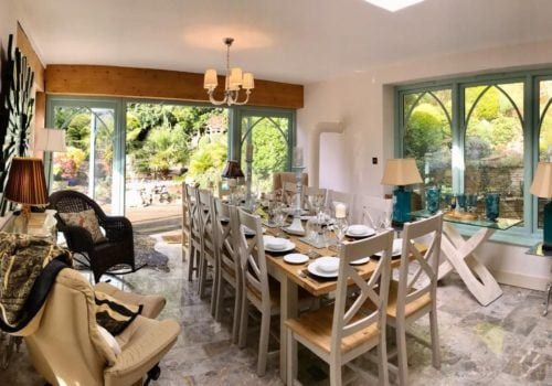 Sumptuous dining room in stunning extension in New Forest cottage stylish marble floor tiles