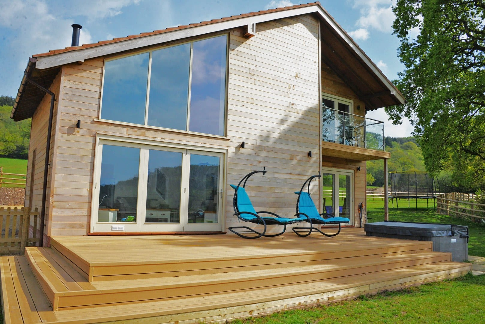 Eco House in Devon, relax on the tweak decking or our yourself a glass of bubbles and sit back in the hot tub taking in the breathtaking views around you