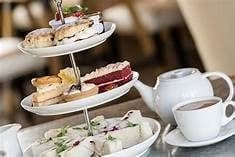 pinkys out for a well organised afternoon tea accompanied by a glass of fizz