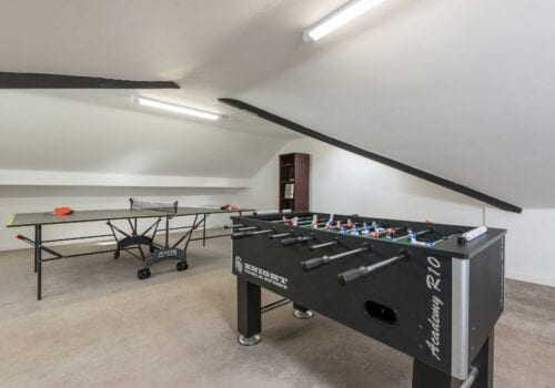 Games room in New Forest Cottage with table tennis and table football