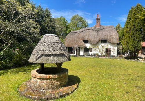 Wishing well at self catering thatched Cottage