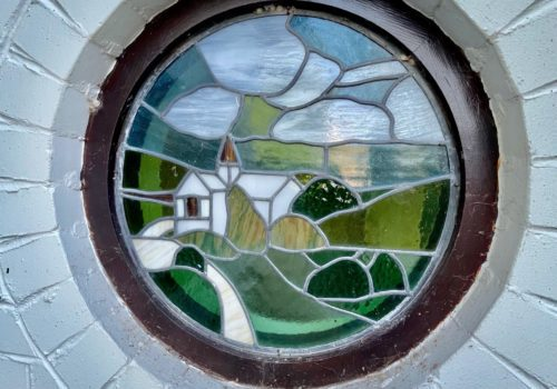 Stained glass detail in thatched holiday let